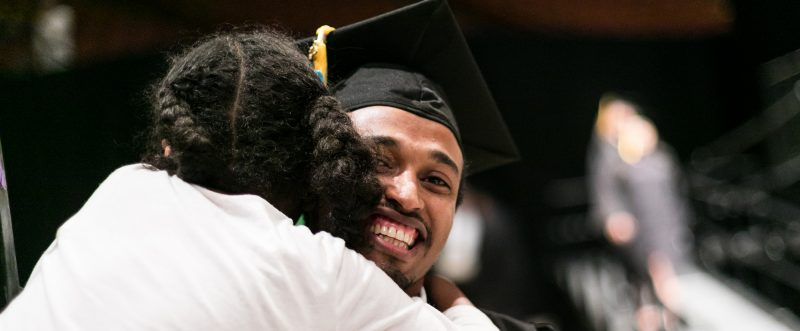 ACC student being hugged at graduation