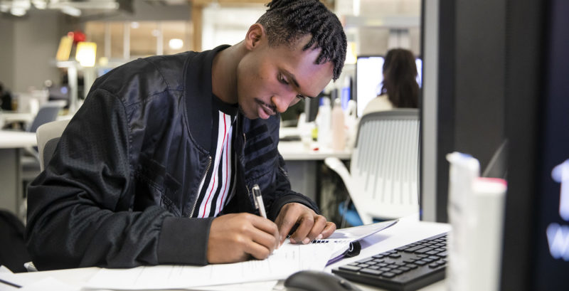 ACC student studies at a computer