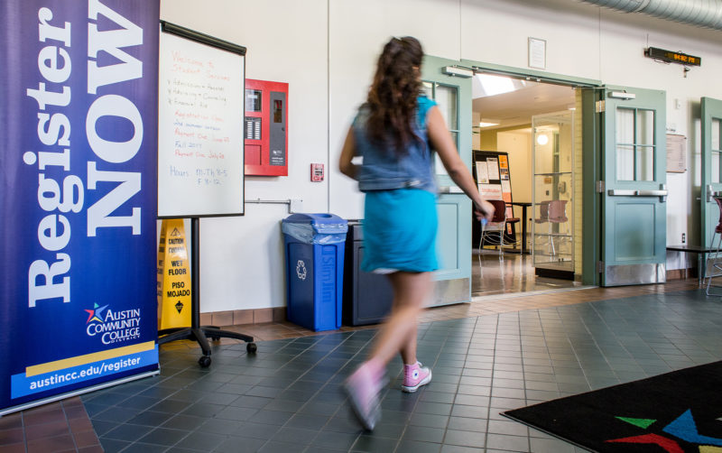 A student walks past registration signage