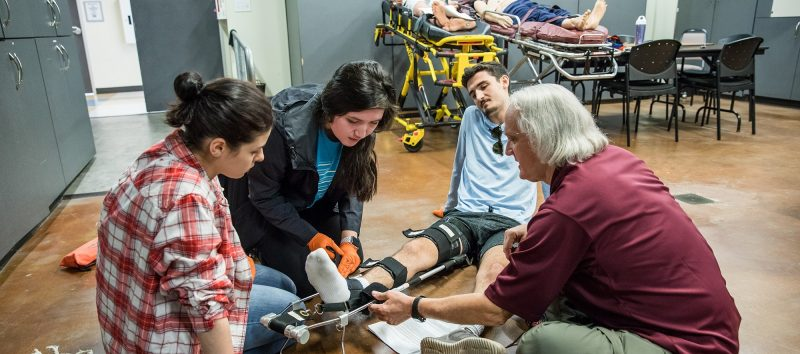 students practing in the EMT lab